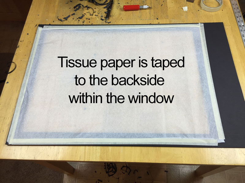 Tissue paper adhered to the back of the top window