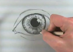 Draw an eye with charcoal - step 3 -layer the pupil