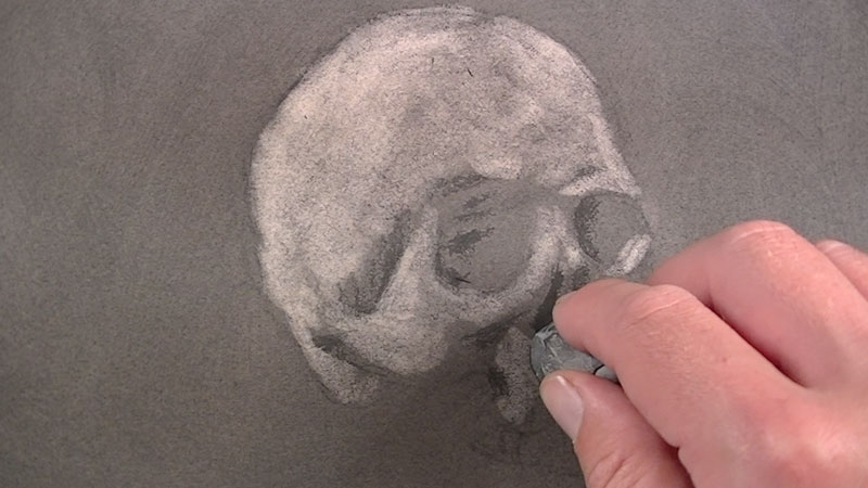 Erase out the highlights with a kneaded eraser