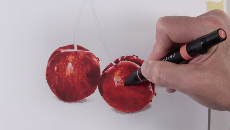 Adding lighter values on the drawing of cherries