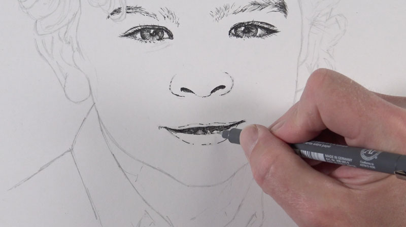 Drawing facial features with pen and ink