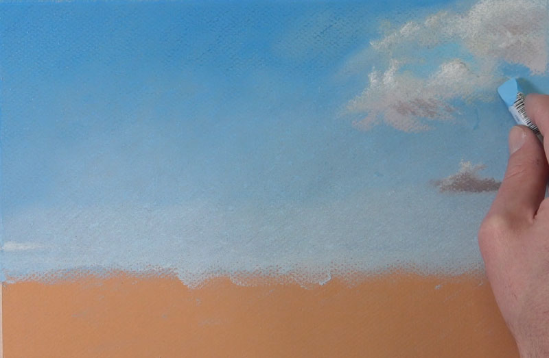 Painting clouds in a pastel landscape