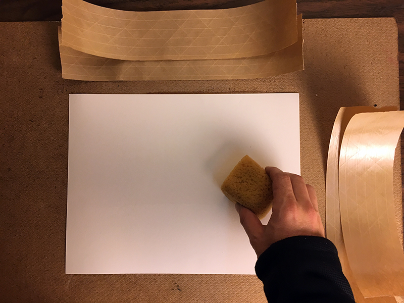Wetting watercolor paper for stretching