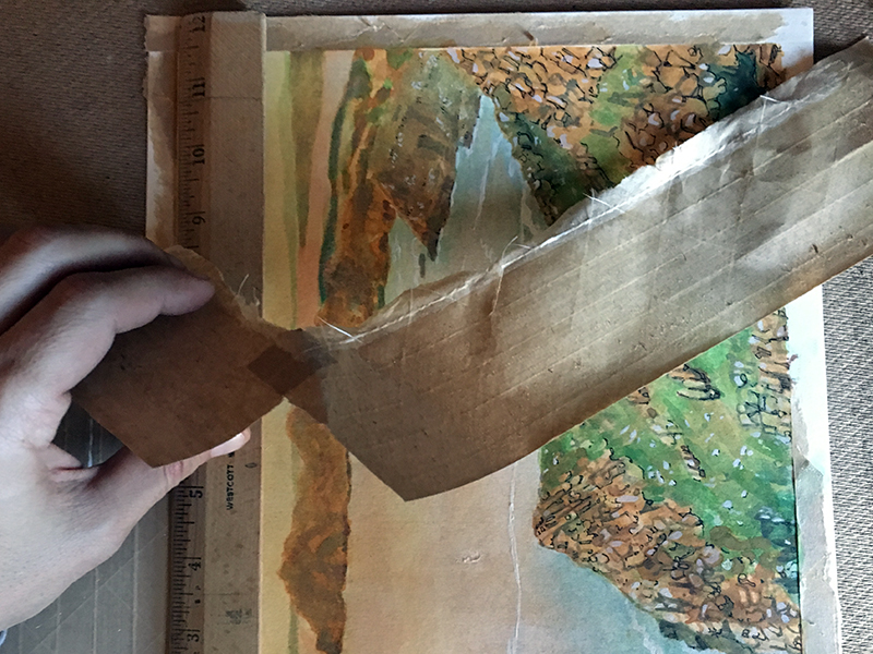 Removing tape from a watercolor painting