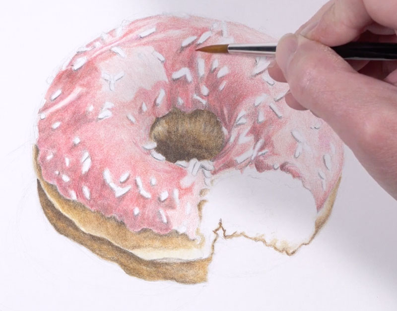 Darkening shadows on the frosting of the doughnut