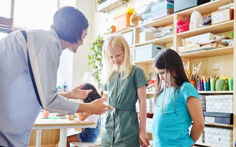 Art teacher disciplines students in art class