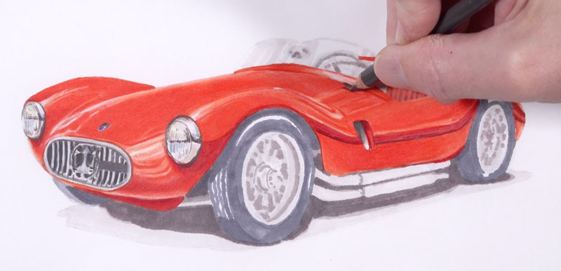 Applying colored pencils to the body of the car