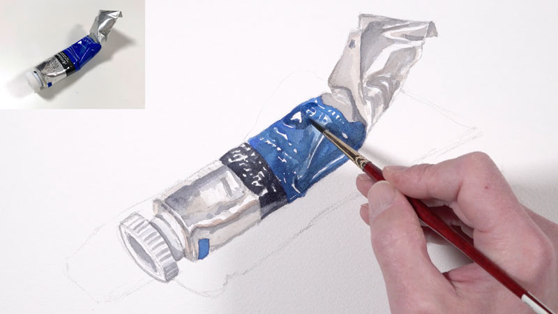 Adding darker values to the watercolor painting of a paint tube