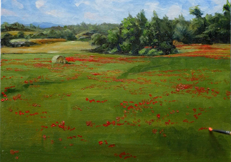 Painting the red flowers and hay bale in the landscape
