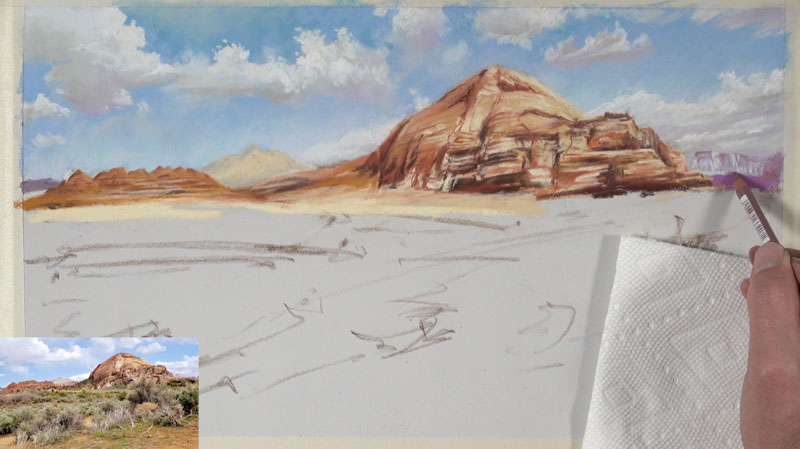 Adding a few details to the distant mountains with pastel pencils