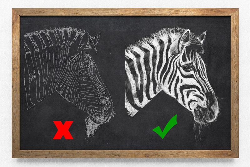 Drawing in reverse on chalkboard