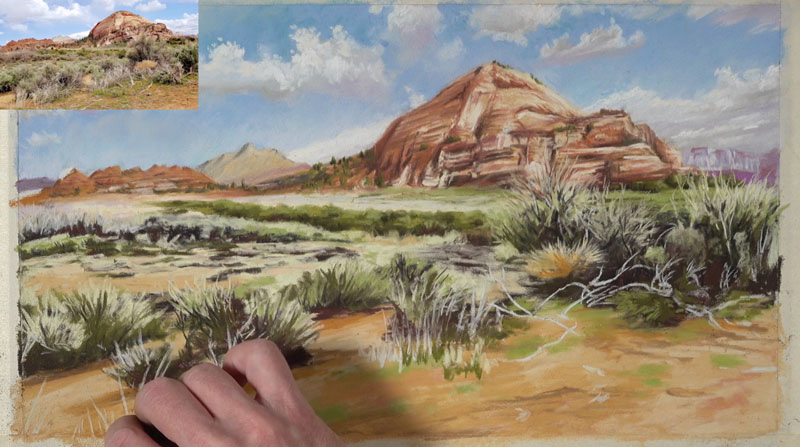 Painting grass in the foreground of the desert landscape