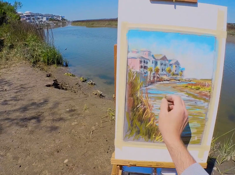 Painting the water with various colors of pastels