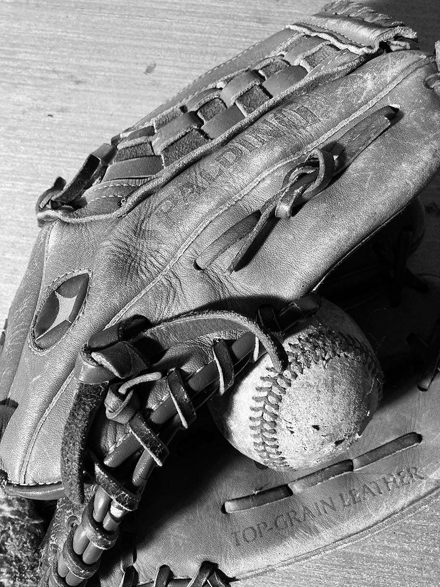 Photo reference of a baseball and glove