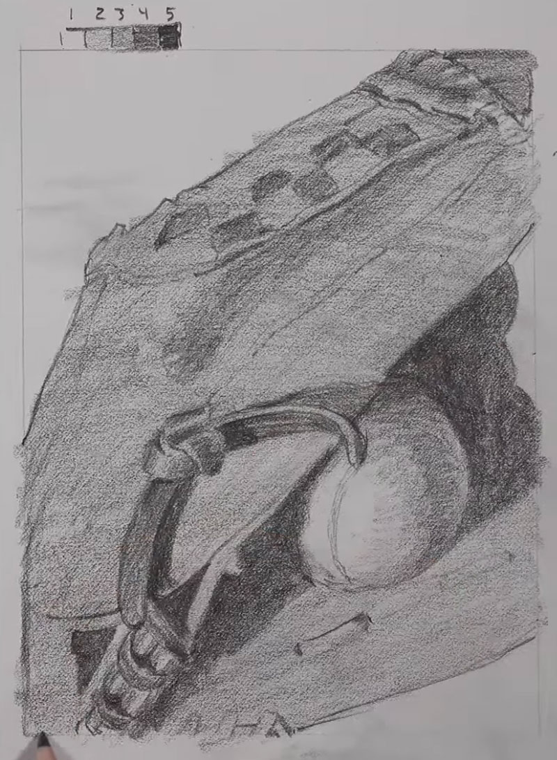 Shading the baseball glove and ball with pencil
