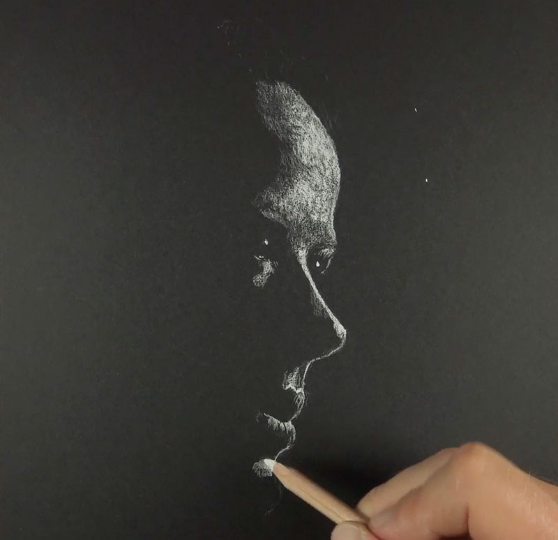 Drawing in the highlights with white charcoal