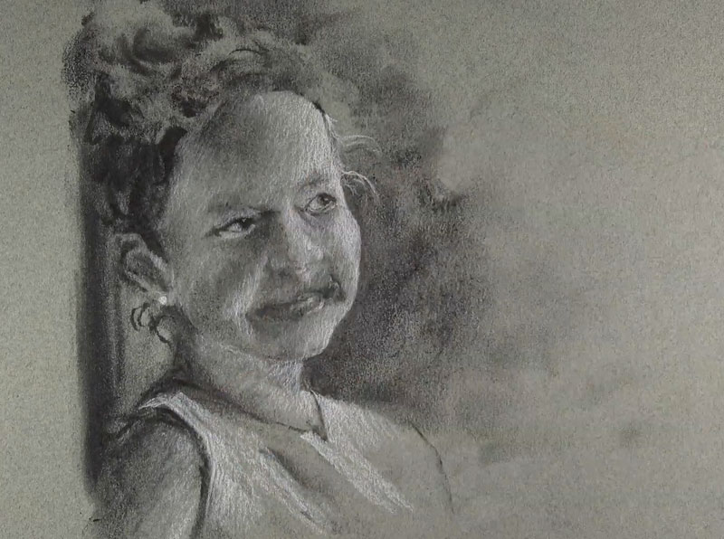 Adding white charcoal to the portrait