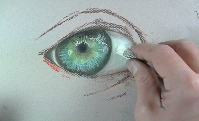 White highlights are painted to make the eye appear white
