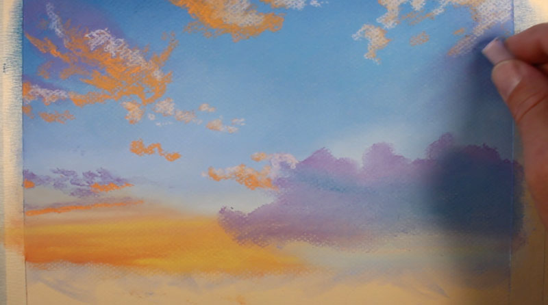 Drawing clouds with pastel